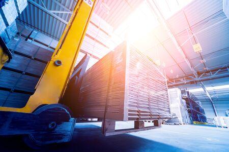 Forklift loader in storage warehouse shipyard. Distribution products. Delivery