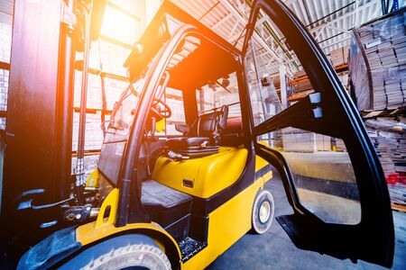 Forklift loader in storage warehouse ship yard. Distribution products. Delivery