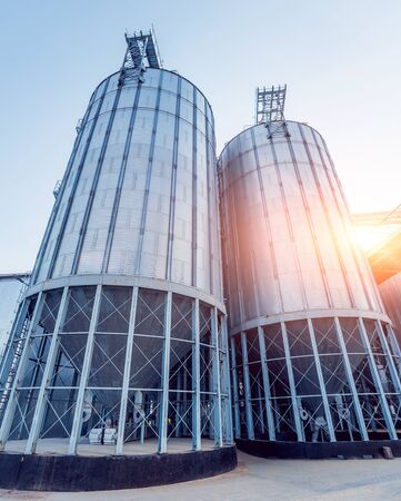 Modern silos for storing grain harvest. Agriculture. Background