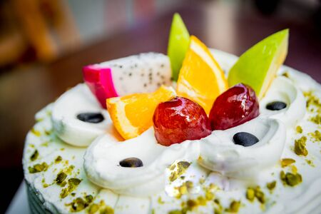 Cream cake with fruit and chocolate. Pastry Shop.