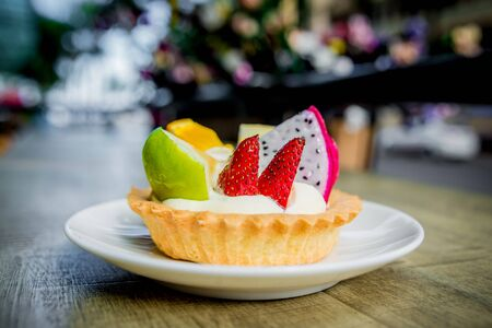 Dessert of biscuits and custard, decorated with fruit. The Restaurant.