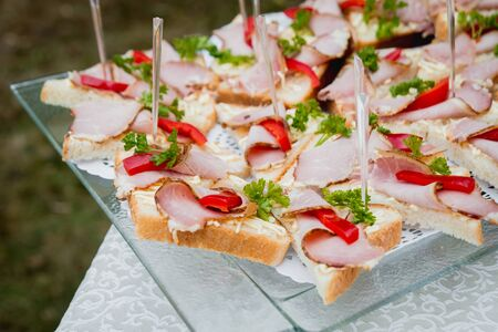 Sandwiches on a large plate. Catering. Restaurant.