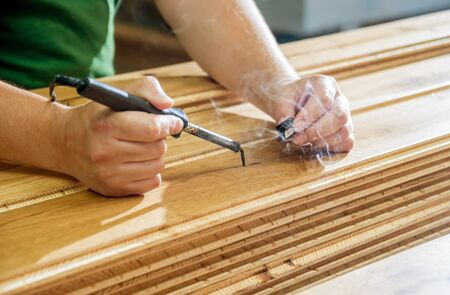 Carpenter with fibreboards at furniture factory workshop. Woodworking industry Stock Photo