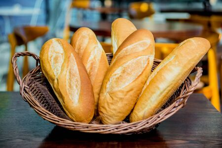 Basket with bread on the table. Bakery.