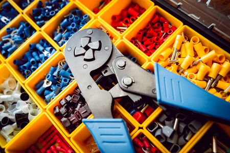 Electrical equipment. Electricity cable and crimper. Background