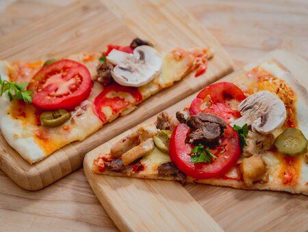 Large pizza on a wooden table. Restaurant. Standard-Bild