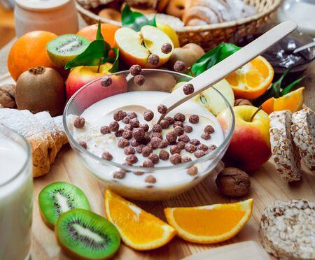 Beautiful breakfast. Milk fruits, bread and croissant. Standard-Bild