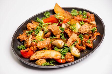 Grilled meat and vegetables. Restaurant. Light background