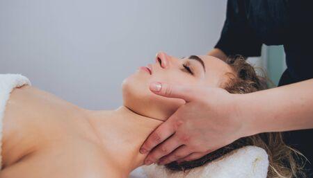 Beautiful woman in spa salon getting facial massage. Relaxing 写真素材