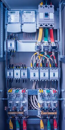 Wires and switches in electric box. Electrical panel with fuses and contactors