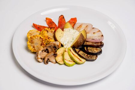 Grilled vegetables and potatoes. Restaurant. Light background.  스톡 콘텐츠