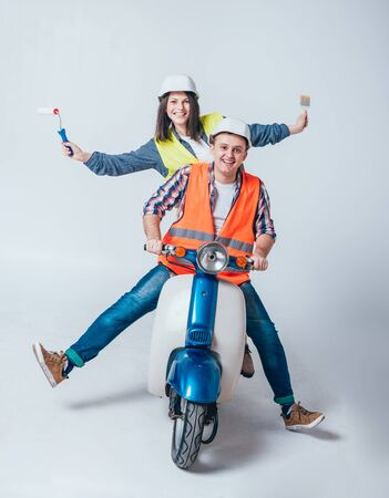 Happy young couple on motorbike. Shopping for the construction and repair of a new home . Stockfoto