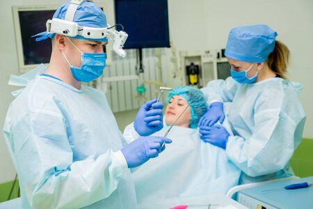 Endoscopic sinus surgery. Laser vaporization of nasal concha Stockfoto