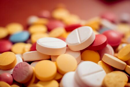 Medications. Pills and syringes. Concept medical background