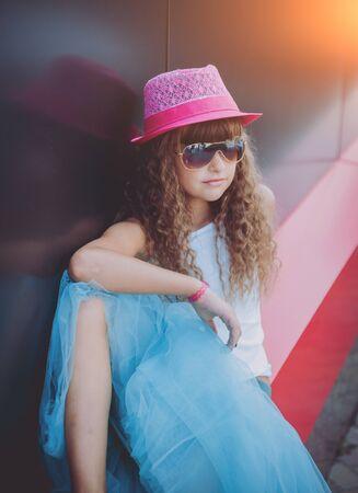 Summer little girl outdoor portrait. Black and red 免版税图像