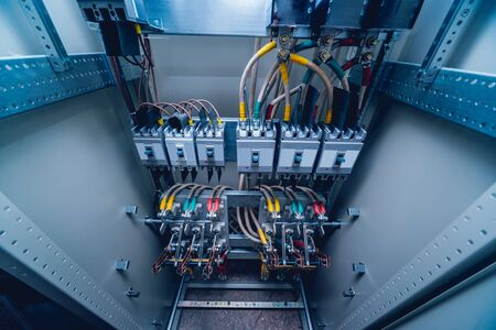Wires and switches in electric box. Electrical panel with fuses and contactors. Background and texture