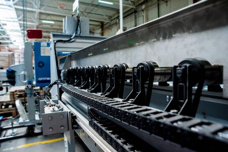 Production line of the wooden floor factory. CNC automatic woodworking machine. Reklamní fotografie