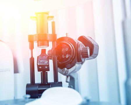 Slit lamp and biomicroscope binoculars. Modern ophthalmic equipment. Background