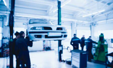 Auto repair service. Blurred background. Auto repair service.  Reklamní fotografie