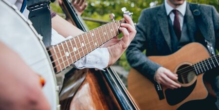 Trio of musicians with a guitar, banjo and contrabass. Authentic background Stock Photo
