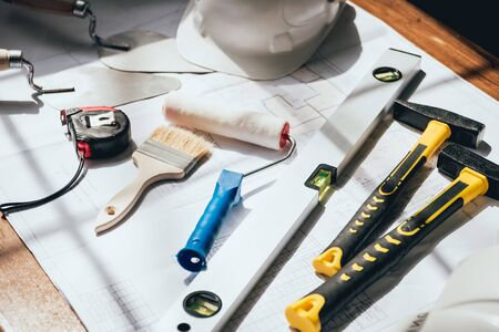 construction tools are on the table. Construction drawing
