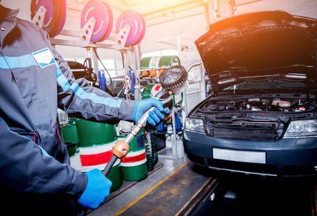 Engine oil change. Car repair. Car service station.