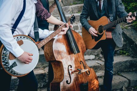 Trio of musicians with a guitar, banjo and contrabass. Authentic background