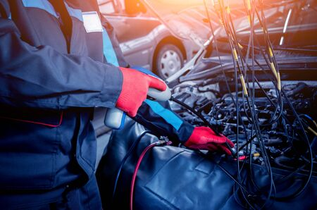 Servicing car air conditioner. Service station. Car service station