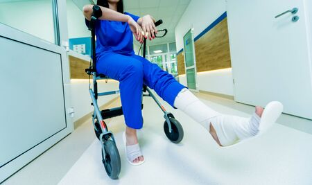 Patient on rollator with hand brakes moving in hospital. Medical concept