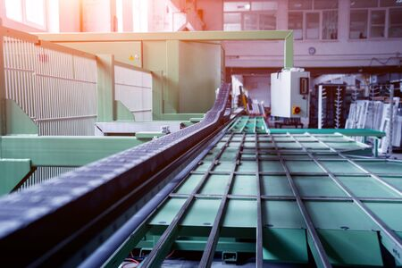 Conveyor belt for production a window pane. Industrial equipment.