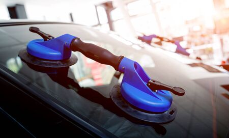 Automotive glazier equipment for replace windscreen. In auto service station garage. Background Stock Photo