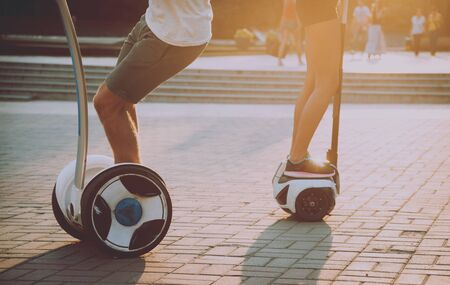 Young couple driving on monowheel in the park