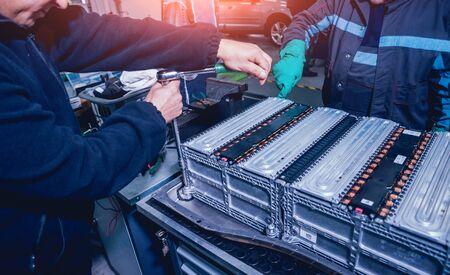 Charging the batteries of the elecric motor. Disassembling the battery of an electric vehicle engine. Car service Zdjęcie Seryjne