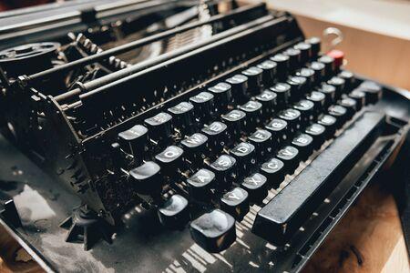 Old vintage typewriter. Keys clouseup background. Abstract blue background 版權商用圖片