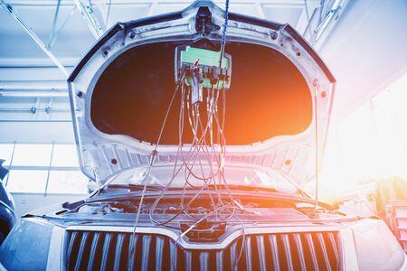 Service station. Car repair wiring. Engine Auto service background