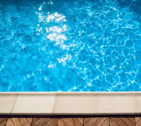 swimming pool with blue water. Textures and background.