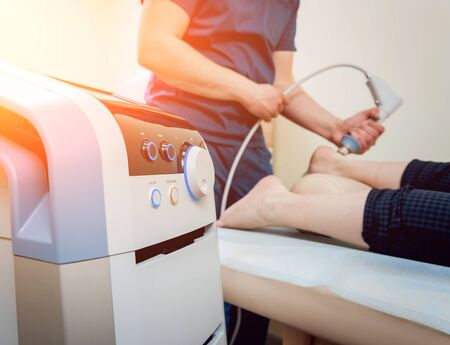 Shock wave therapy. The magnetic field, rehabilitation Stock Photo