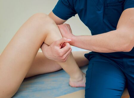 Patient with orthopedist doctor in his office. Knee injury