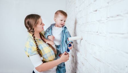 Happy family in new house. Construction and renovation
