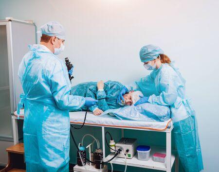 Endoscopy at the hospital. Doctor holding endoscope before gastroscopy. Medical examination