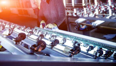 Conveyor belt for production a window pane. Industrial equipment. 免版税图像