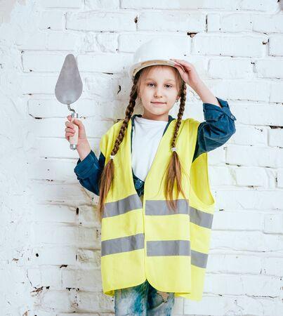 Little girl on the white background. Construction Standard-Bild