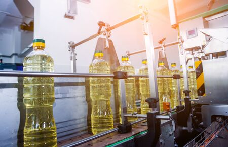 Bottling line of sunflower oil in bottles. Vegetable oil production plant. Stock fotó