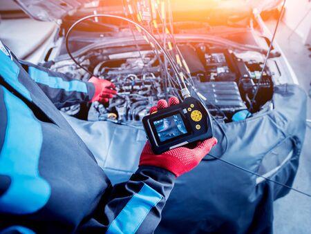 Video investigate. Engine diagnostics. Car repair. Service station background