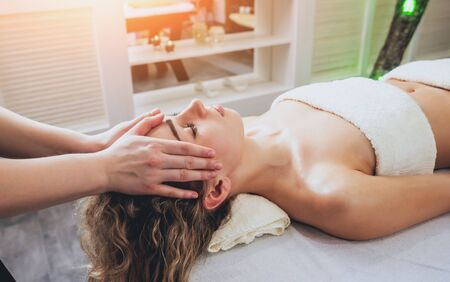 Beautiful woman in spa salon getting facial massage. Relaxing 版權商用圖片