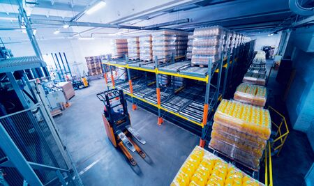 Warehouse at the beverages factory. Industrial light background. Foto de archivo