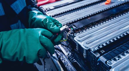 Charging the batteries of the elecric motor. Disassembling the battery of an electric vehicle engine. Car service
