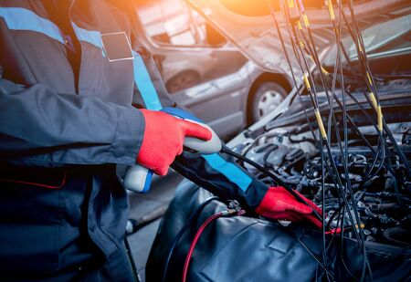 Servicing car air conditioner. Service station. Car service Stock Photo