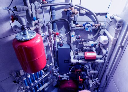 Modern heating system in boiler room. Automatic control unit. Engineering systems for home.