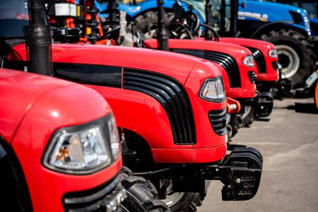 Rows of modern tractors. Industrial details. Agricultural exhibition Stockfoto - 150296626